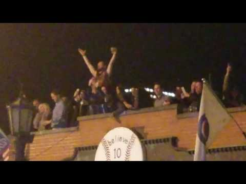 Drunk Chicago Cubs players sing Go Cubs Go from Murphy's Wrigleyville roof after Cubs Victory Parade