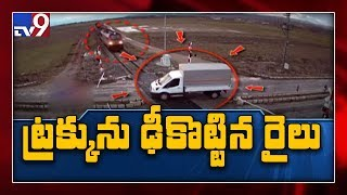 Truck hit by train, pushed 500 yards down track - TV9