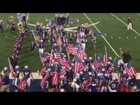 Entire High School football team runs out with American Flags!
