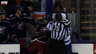 Matt Martin tries to drag Scott Harrington out of Blue Jackets bench after hit