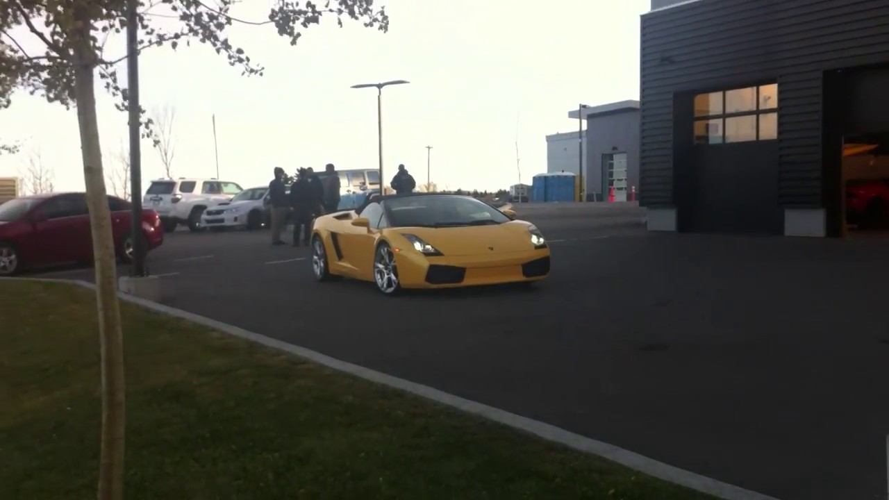 Yellow Lamborghini Gallardo Spyder Driven Into Dealership Workshop