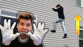 extremely sticky duct tape wall climbing spider man style