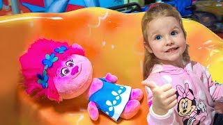 Little girl and Funny Trolls on the playground Nursery Rhymes Song for children
