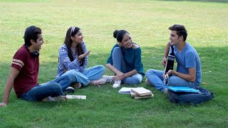 Young musician playing guitar and singing songs for his college friends - leisure time