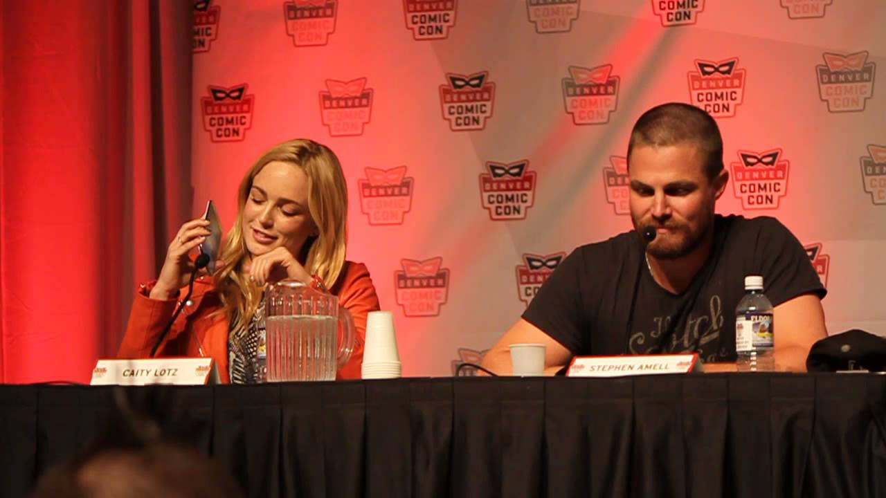 caity lotz and stephen amell during the arrow panel at