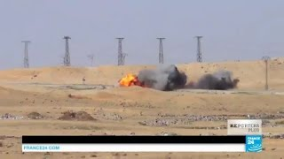 EXCLUSIVE - Syria: Kurds destroy a suicide bomber's truck filled with explosives coming at them
