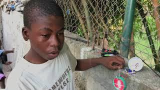 Boy In Haiti Makes Rechargeable Light Bulb