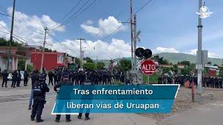 Elementos de la Guardia Nacional y de la Secretaría de Seguridad Pública desplegaron dispositivos de seguridad para restablecer la circulación en las vías férreas cuando fueron atacados por maestros y normalistas en el municipio de Uruapan