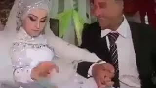 عريس يبوس عروسته فى الكوشه