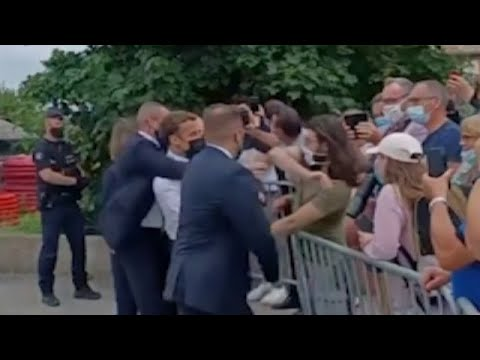 Watch French President Macron get slapped across the face while in southern France