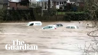 Storm Dennis: cars swept away by flooding in Wales