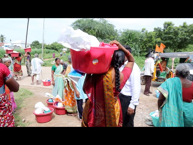 Distributing food to impoverished widows in India