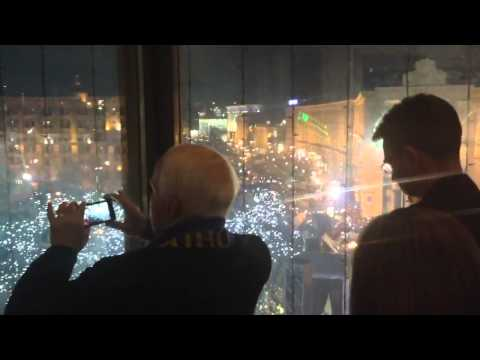 McCain is taking  photos of protesters in Kiev