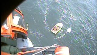 Air Station Port Angeles Washington hoists a man from 18ft skiff in 40-knot winds