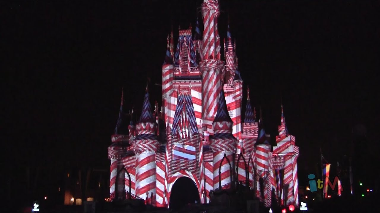 christmas projections on cinderella castle during celebrate the magic finale at walt disney world