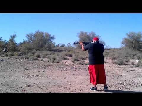 Fat guy shooting ak47