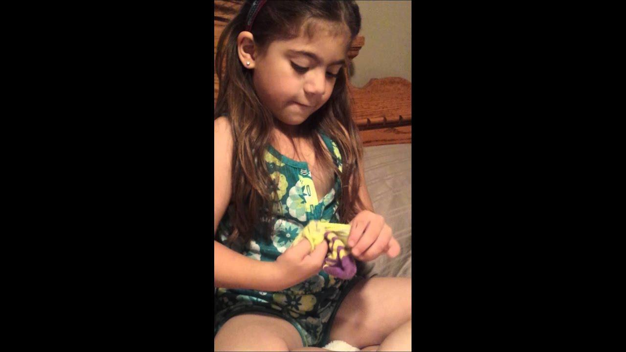 Cute little girl shows how to fold socks :)