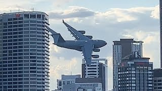 Plane Flies Between Buildings