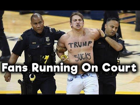 NBA Fans Running On Court
