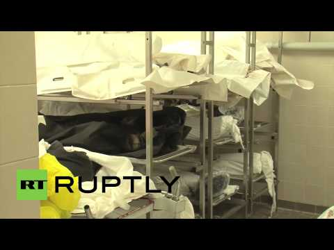 Libya: Relatives forced to identify bodies after violent clashes *GRAPHIC*