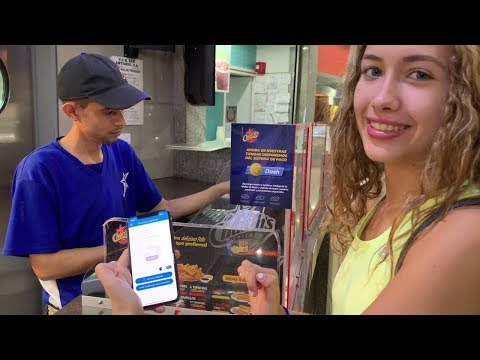 Isabel Paying With Dash At Church's Chicken In Caracas, Venezuela