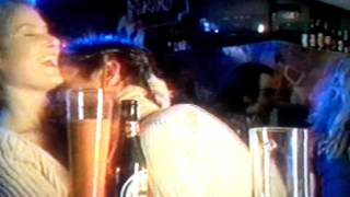 Horny drunk couple at a bar.