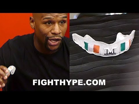 FLOYD MAYWEATHER UNVEILS IRISH MOUTHPIECE; HINTS AT BITING DOWN ON IT FOR MCGREGOR CLASH