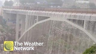 SEE IT: Heavy rainfall turns bridge into ACTUAL waterfall