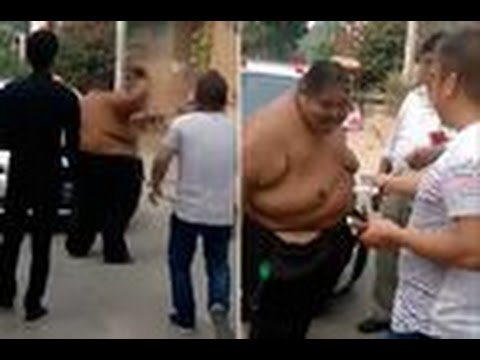 Hulk no smash! Bizarre moment overweight man gets paid in cash so he won't bash up wedding car !