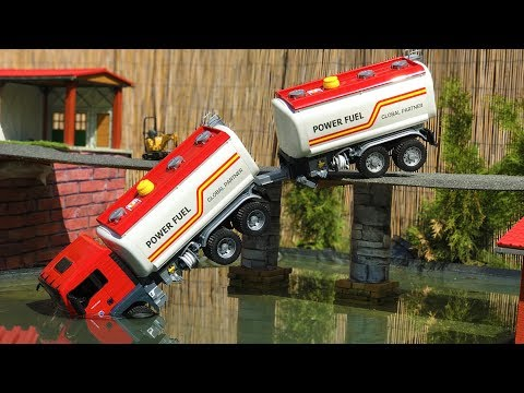 BRUDER TOYS tank truck BRIDGE CRASH! | Kids video | Jamara excavator at work