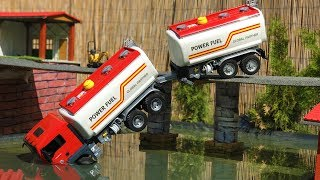 BRUDER TOYS tank truck BRIDGE CRASH! | Kids video | Jamara excavator at work