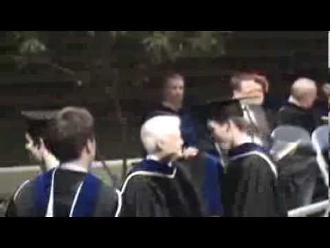 Devin Moss Receiving Masters Degree Diploma