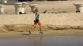 SUPER FIT GIRL RUNNING THE BEACH IN SLOW MOTION in HD