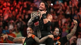 roman reigns celebrates winning the wwe world heavyweight title with his family dec 14 2015