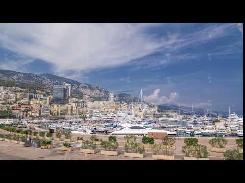 Monte Carlo Port Hercule panorama timelapse hyperlapse. View of luxury yachts and houses around