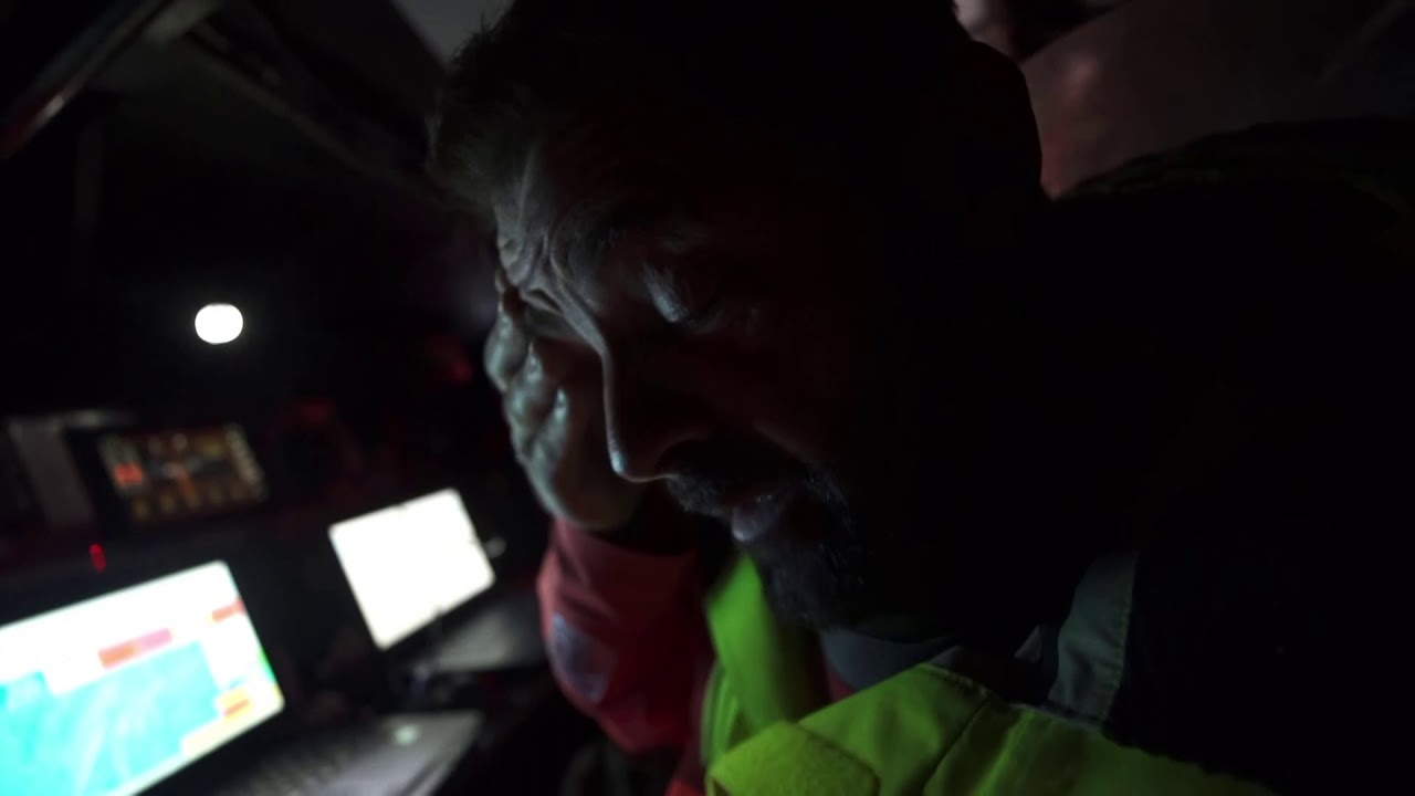"Pascal rubs his eyes at the nav station. Charles looks on. They talk in French. Pascal: Honestly, for the moment we are far behind, but they have to turn around 40 miles before the finish line and come back. I hope the next wind's on us, a lot. But we will see. It's a bit crazy we have been racing for 9 months and it's only the 40 last miles of the last leg is going to decide who is going to win the Volvo Ocean Race. It's crazy. Charles gets dressed and talks to Pascal in French; something about ""a cyclone and we flap flap flap!"" He tells Martin: If they get some light pressure we can come back. We win or not in one hour but not two hour (?). Wait and see."