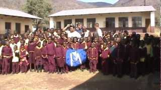 SCI Northeast Indiana - Blue Bag Delivery To School in South Africa - Kids Sing