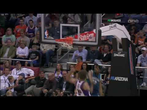 Corey Brewer slam dunks the ball over Robin Lopez