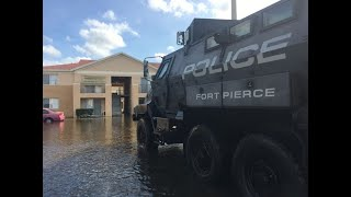 Fort Pierce police use MRAPS to help people in flooded areas