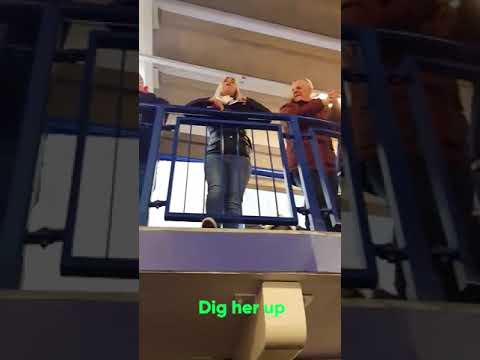 Female Chelsea fan leads the chant a Leicester