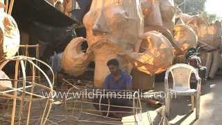 Indian craftsmen make effigies of the Hindu demon king Ravana