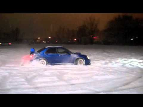 Subaru WRX STI snow drift in car and out lot