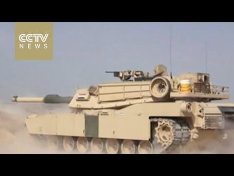 Iraqi forces battle ISIL militants outside Fallujah