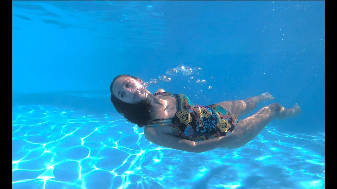 Carla underwater swimming in a cool hotel pool