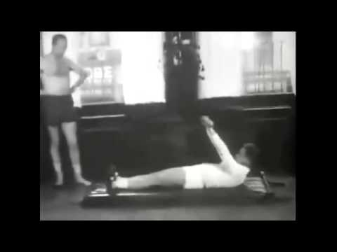 vintage video of Joseph Pilates demonstrating some of his mat exercises to a client