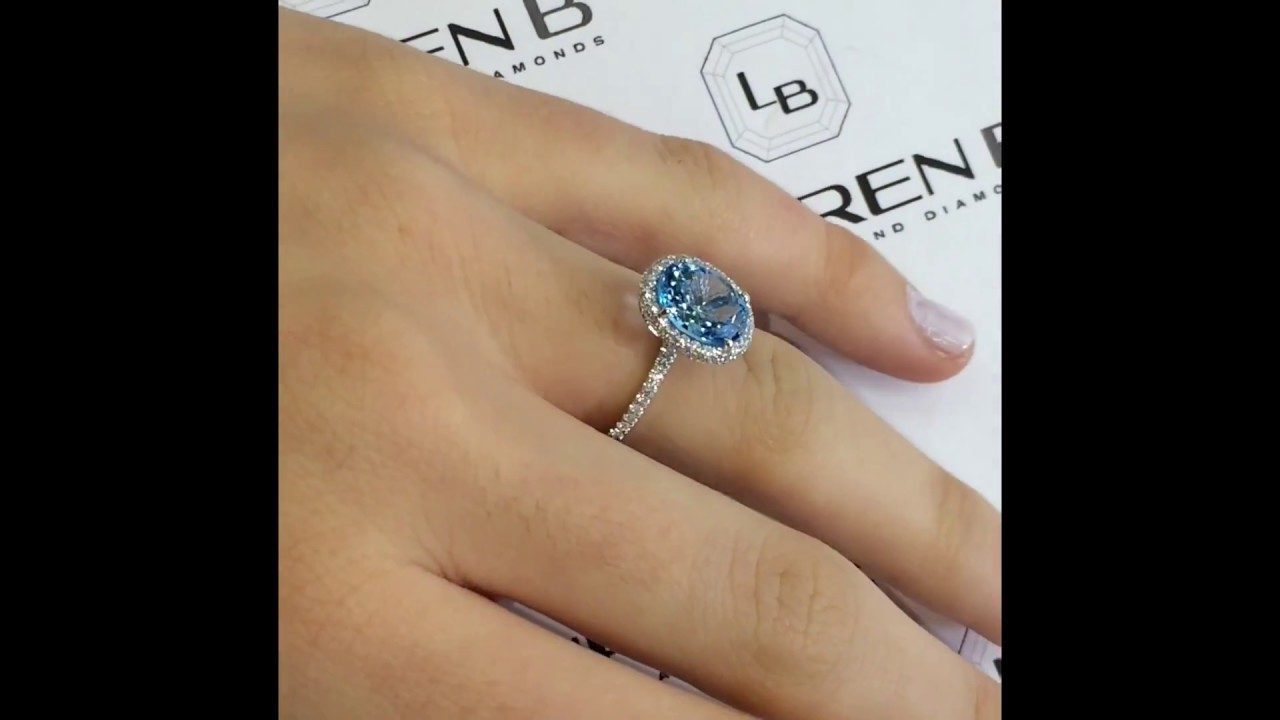 Lauren B Gem Collection: Blue Topaz Oval Halo Engagement Ring