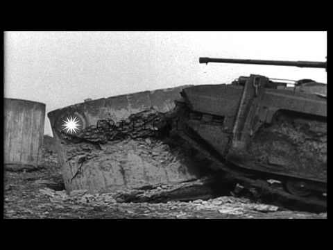 Fire from a British 2 pounder anti tank gun to remove the beach obstacles in Grea...HD Stock Footage