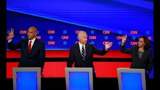 Biden battles through another Democratic debate