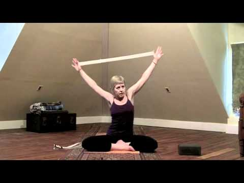 simple shoulder stretch using a d ring yoga strap  youtube