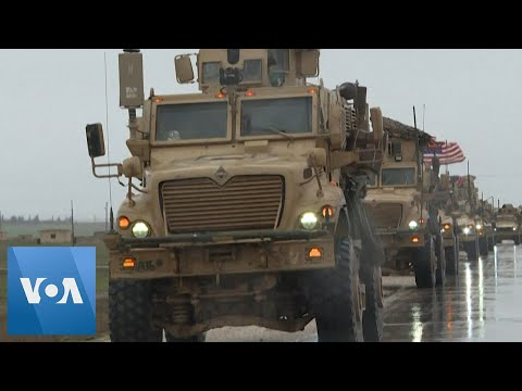 US Convoy of Military Vehicles Patrols Syria's Tal Tamr